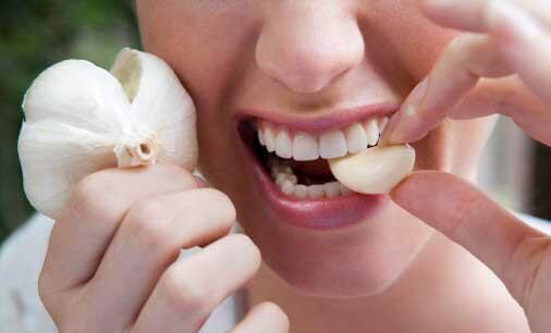 Bị mọc răng khôn phải làm sao? 2